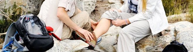 Picture: A hiker checks a fellow hikers ankle pain for tendinitis.