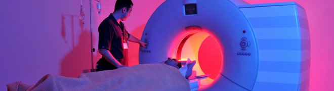 Picture: A medical technician prepares a patient for an MRI to check for a possible brain tumor.