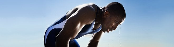 Picture: An exhausted athlete hunched over suffering from dehydration. 