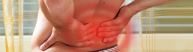 A man experiences muscle spasms in his lower back.