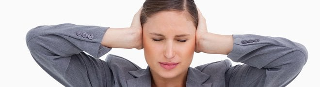 Picture: A woman suffering tinnitus covers her ears to stop the ringing. 