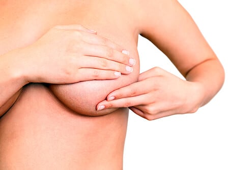 Picture of a woman performing a self-examination of her breast