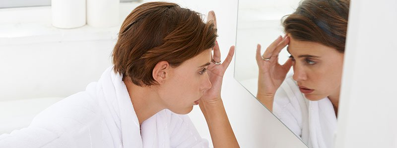 Women's refection in the bathroom mirror.