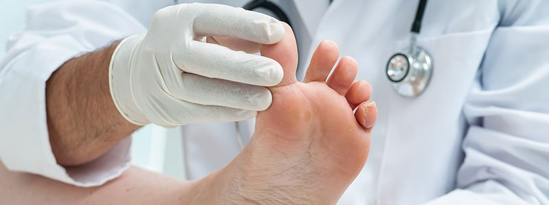 Doctor examining a patient's foot.