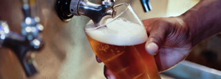 Image of a glass filling with beer.