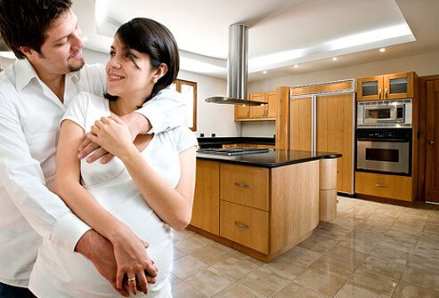 A couple enjoys their new kitchen.