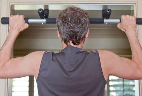 Photo of a man performing the pull-up exercise.