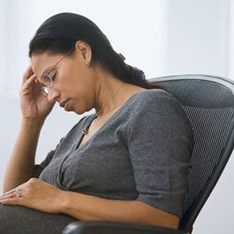 Woman feeling weak, tired, and fatigued.