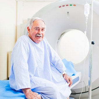 A senior man prepares for a virtual colonoscopy done via CT scan.