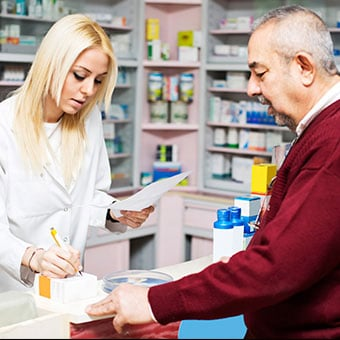 A man picks up his prescription for congestive heart failure at a pharmacy.