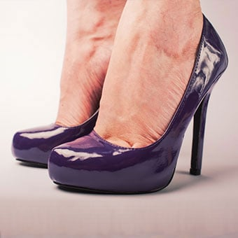 A woman wears shoes with a very high heel, which can cause corns and calluses.