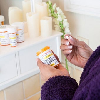A woman takes antifungal nail medication.