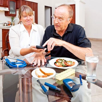 A dietician discussing food options with a senior kidney patient.