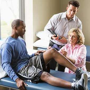 Alt TextMedical professionals evaluate the need for knee replacements.
