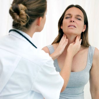 A doctor examines a woman's lymph nodes (glands).