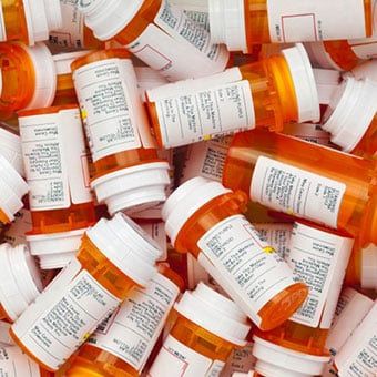 An assortment of prescription medication bottles.
