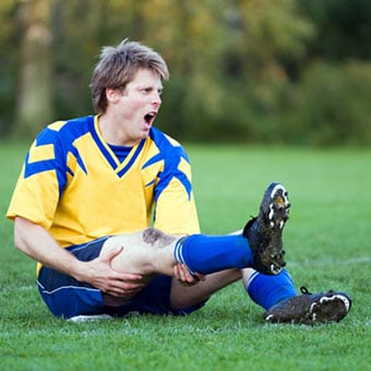A soccer player suffers a leg muscle cramp.