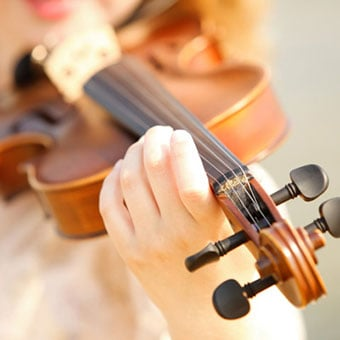 A girl plays the violin.