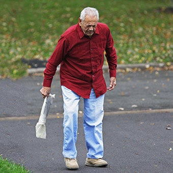 A man with rheumatoid arthritis (RA) limps after retrieving his newspaper.