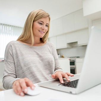 A woman searches the Internet for more information about rosacea.