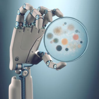 An artificial hand displays a petri dish of bacterial and fungal colonies.