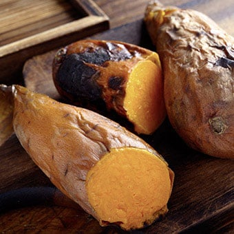 Baked sweet potatoes on a cuttng board.