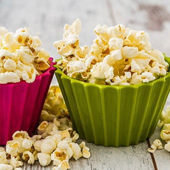 Colorful bowls of popcorn.