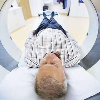 A man gets an MRI of his head to look for possible causes of vertigo.