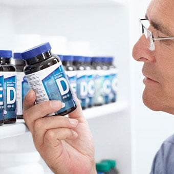 A man shops for vitamin D supplements.