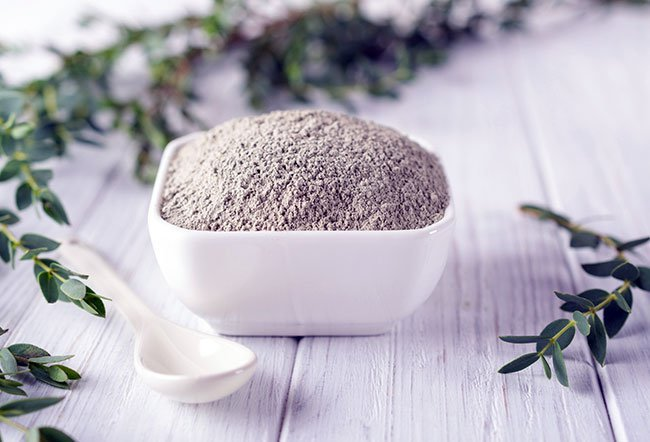Bentonite clay is an ancient home remedy that is used for a variety of issues. Bentonite clay is used to treat acne, wounds, ulcers, skin allergies, bloating and diarrhea.