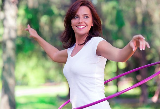 Including hula hooping in your daily routine may help you burn calories, shed fat, and tone your muscles for a slim waist.