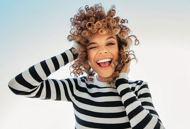 Hair type and texture are determined by many factors including genetics. The four hair types are type 1 straight, type 2 wavy, type 3 curly and type 4 tight curls.