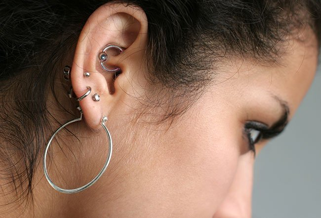 Ear piercing may be done with a sterilized needle or a piercing gun. There are 15 locations on the ear that you can pierce. Piercing through the cartilage is the most popular type of ear piercing currently.