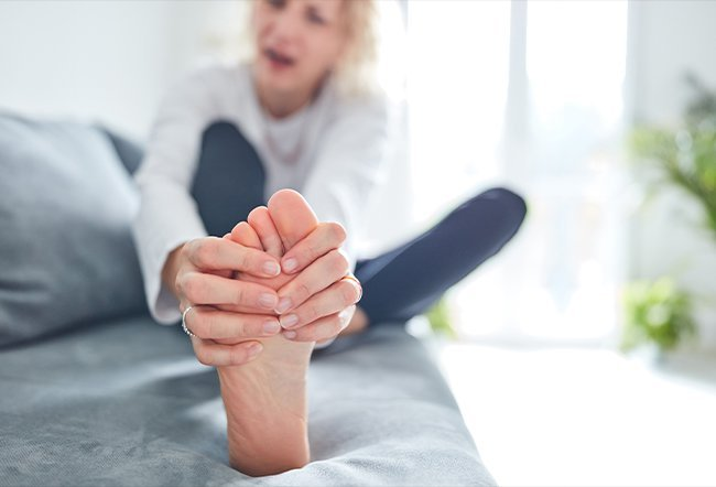 Psoriatic arthritis causes joint pain, swelling, and stiffness. Psoriatic arthritis pain is described as worse in the morning or after resting, tender, throbbing, warm to the touch, and exhausting. It primarily affects the knees and ankles, but can also occur in the neck, lower back, hips, shoulders, heels, and feet.