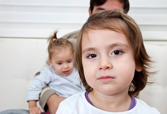 what age can a child stay home with sibling