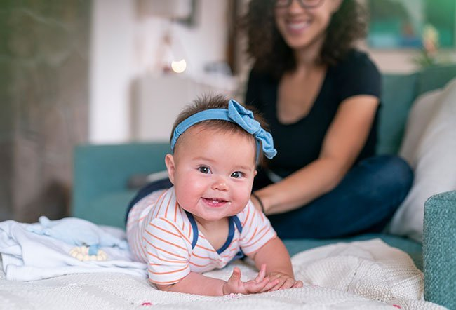 Babies at five months of age are developing rapidly.