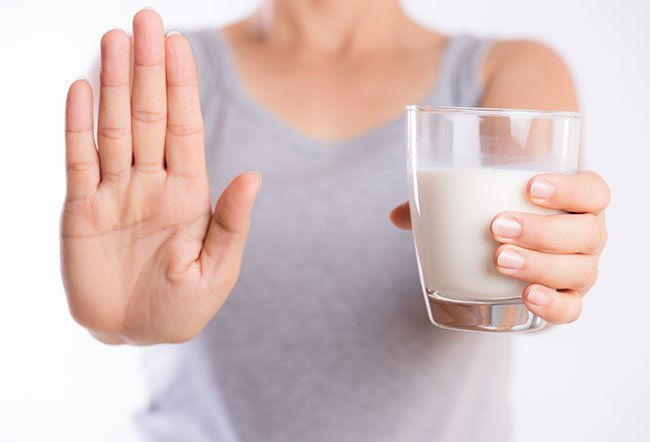 Lactose intolerance is caused by a deficiency of an enzyme (lactase) that helps digest the sugar (lactose) in milk. Milk allergy, on the other hand, is an adverse immune reaction to proteins found in milk. The symptoms of the two conditions are different.