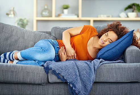 Woman experienceing stomach pain