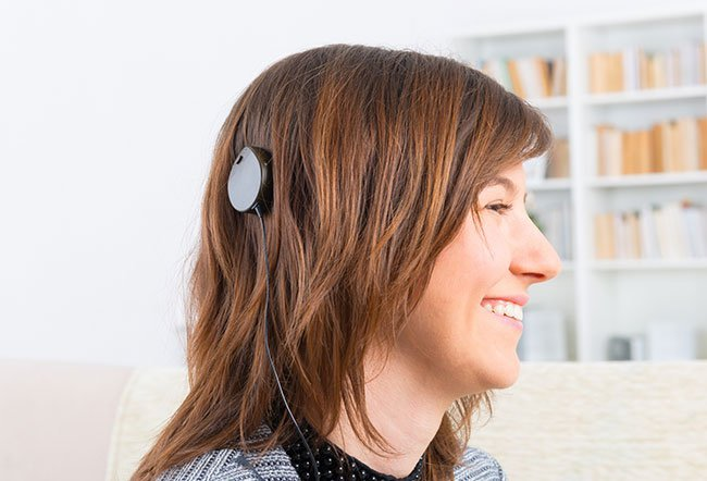 A cochlear implant is a device that helps people hear after hearing aids do not work.
