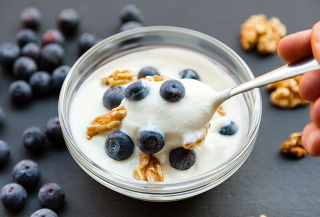 Greek yogurt is a high-protein yogurt produced by bacterial fermentation of lactose present in milk, releasing lactic acid that coagulates milk proteins and produces typical aromatic compounds. Health benefits of Greek yogurt include better mood, blood sugar levels, immunity, muscles, bone strength and healthier blood.
