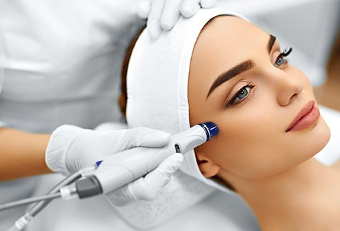 Dermabrasion treats deeper layers of skin compared to microdermabrasion.
