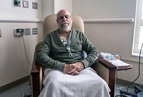 Image of a man receiving chemotherapy drugs intravenously.