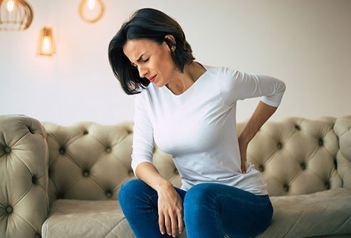 Lower back pain is the most common symptom of spondylolisthesis.