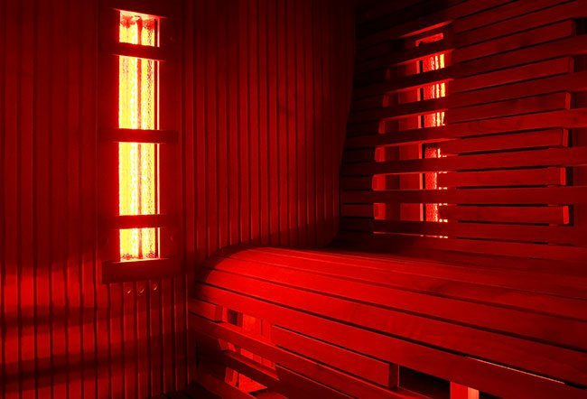 Sauna is a small room used for a hot air or steam bath. In a traditional sauna, moist heat is used to warm the room air that in turn warms your body. This heat is said to be beneficial to the body.