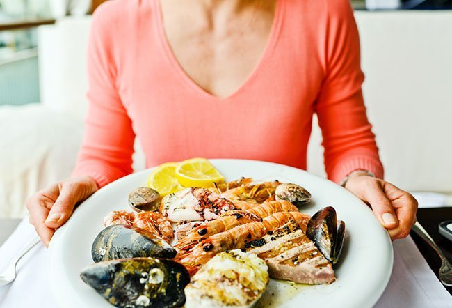A buildup of uric acid, caused by purines, in the body causes gout. Foods that are high in purines include all alcoholic drinks, shellfish and certain other types of fish, bacon, turkey, veal, liver, and venison.