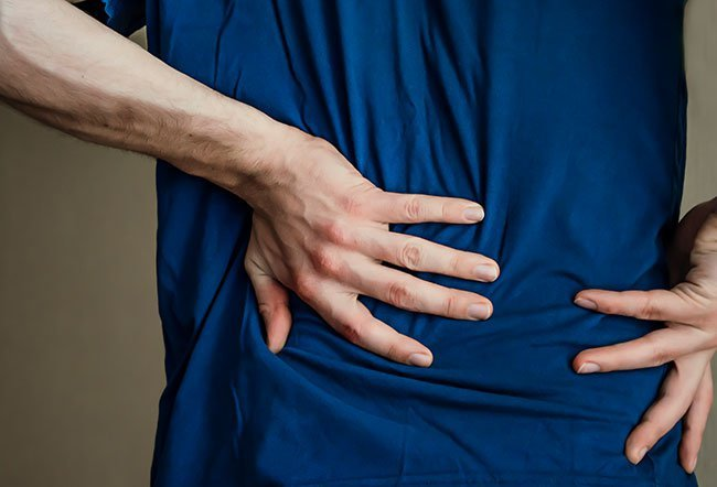 Middle back pain is a common complaint in middle-aged individuals who sit for long hours at work.