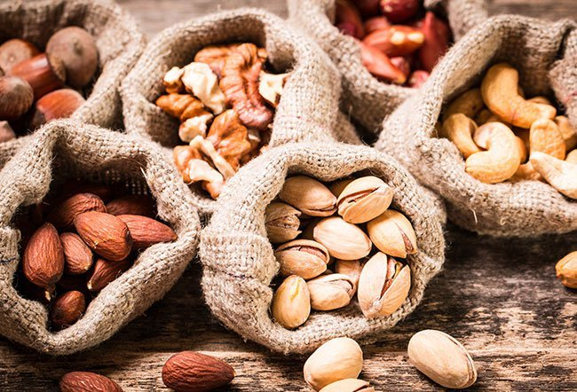 A nut allergy develops when the body's immune system becomes oversensitive to a particular protein in a nut. Nuts that are the worst for allergies include peanuts, walnuts, pecans, almonds, Brazil nuts and pine nuts.