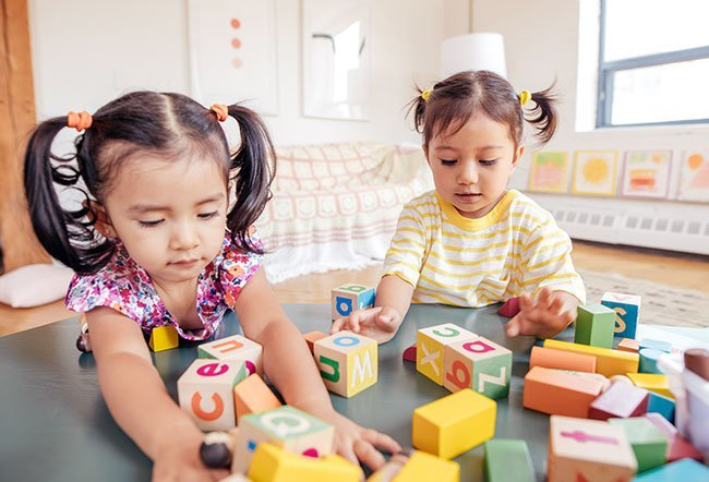 At two years old, developmental milestones are directed at behaviors that can display a range of cognitive and physical accomplishments. At 2 years old, your child should be able to walk up the stairs, scribble, run, kick a ball, join in during family mealtimes and other activities.