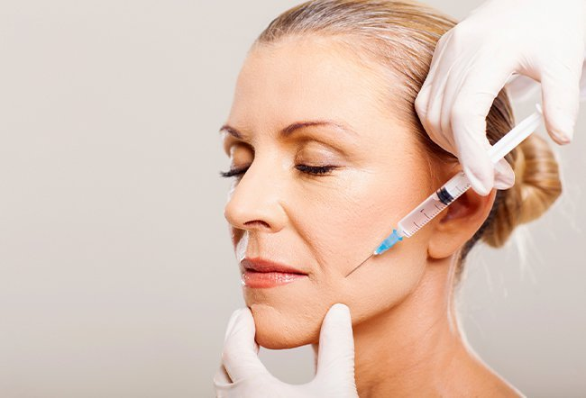 Deep wrinkles near the mouth (also known as perioral wrinkles) appear when ligaments around the mouth and chin loosen. Get rid of deep wrinkles around your mouth by eating an antioxidant-rich diet, adopting healthy lifestyle habits and using good skincare products.