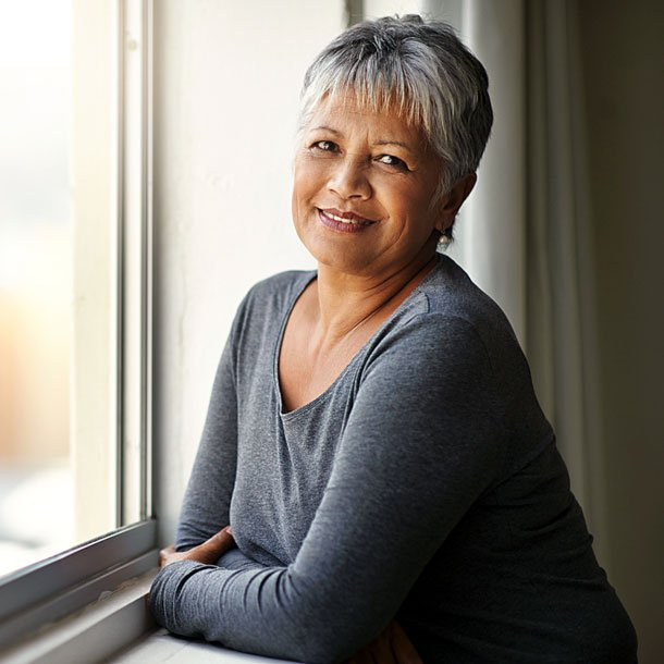 """Menopause is the point in life when a woman stops ovulating (the ovaries stop producing eggs), menstrual periods end, and she is no longer able to become pregnant. During this time, body fat often settles around the midsection, which is called """"menopause belly."""""""